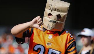 A Cincinnati Bengals fan reacts in the second half of an NFL football game against the Jacksonville Jaguars, Sunday, Oct. 20, 2019, in Cincinnati. (AP Photo/Gary Landers)
