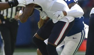 Houston Texans quarterback Deshaun Watson (4) is sacked by Indianapolis Colts defensive end Jabaal Sheard (93) during the first half of an NFL football game, Sunday, Oct. 20, 2019, in Indianapolis. (AP Photo/Doug McSchooler)