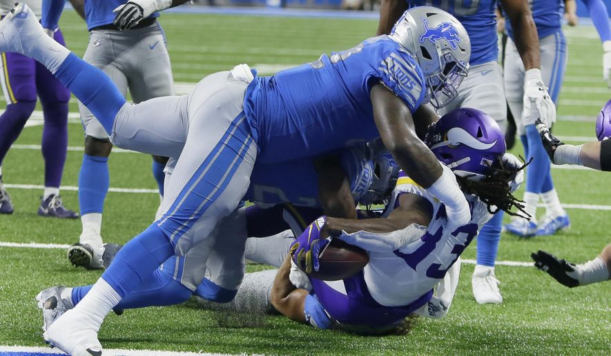 Minnesota Vikings running back Dalvin Cook (33) holds the ball over the goal line to score while he is tackled by Detroit Lions defensive tackle Kevin Strong during the first half of an NFL football game, Sunday, Oct. 20, 2019, in Detroit. (AP Photo/Duane Burleson)
