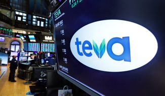 The logo for Teva appears above a trading post on the floor of the New York Stock Exchange, Monday, Oct. 21, 2019. The nation's three dominant drug distributors and a big drugmaker have reached an over $200 million deal to settle a lawsuit related to the opioid crisis just as the first federal trial over the crisis was due to begin Monday. Drugmaker Teva would contribute $20 million in cash and $20 million worth of suboxone, a drug used to treat opioid addiction. (AP Photo/Richard Drew) **FILE**