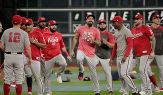 MVP candidate Anthony Rendon (middle) and his Nationals teammates hope to bring a baseball title to the District for the first time in 86 years when they play the Houston Astros in the World Series. (Associated Press)