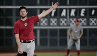 Washington Nationals starting pitcher Max Scherzer warms up during batting practice for baseball's World Series Monday, Oct. 21, 2019, in Houston. The Houston Astros face the Washington Nationals in Game 1 on Tuesday. (AP Photo/David J. Phillip)