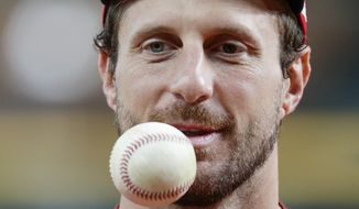 Washington Nationals starting pitcher Max Scherzer warms up during batting practice for baseball's World Series Monday, Oct. 21, 2019, in Houston. The Houston Astros face the Washington Nationals in Game 1 on Tuesday. (AP Photo/Eric Gay) **FILE**
