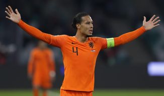Netherlands' Virgil van Dijk gestures during the Euro 2020 group C qualifying soccer match between Belarus and Netherlands at the Dinamo stadium in Minsk, Belarus, Sunday, Oct. 13, 2019. (AP Photo/Sergei Grits)