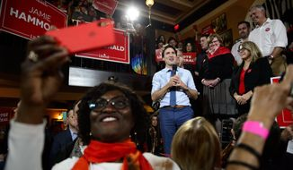 Canadian Prime Minister and Liberal leader Justin Trudeau holds a rally at a pub in Victoria, British Columbia,  Sunday, Oct. 20, 2019. (Sean Kilpatrick/The Canadian Press via AP)