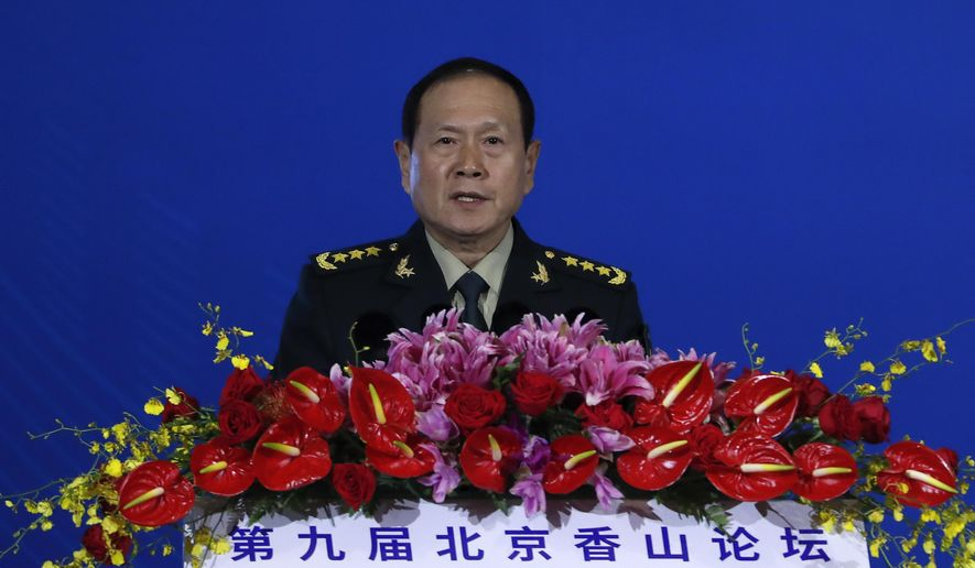 """Chinese Defense Minister Wei Fenghe delivers his opening speech for the Xiangshan Forum, a gathering of the region's security officials, in Beijing, Monday, Oct. 21, 2019. Wei issued a stinging rebuke of the U.S. at a defense forum in Beijing, saying China wasn't fazed by sanctions, pressure and a """"big stick policy."""" (AP Photo/Andy Wong)"""