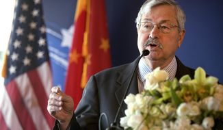 FILE - In this June 30, 2017, file photo, U.S. Ambassador to China Terry Branstad speaks during an event in Beijing. Branstad on Monday defended plans to require Beijing's diplomats to report contacts with some Americans and said Monday that Washington is considering additional rules for employees of entities controlled by the ruling Communist Party. (AP Photo/Mark Schiefelbein, Pool, File)