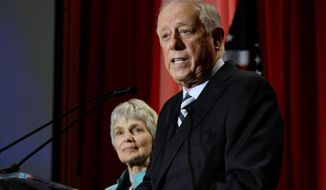 FILE- In this Nov. 6, 2018 file photo, Democratic Senate candidate, former Gov. Phil Bredesen speaks to supporters after he conceded to Rep. Marsha Blackburn, R-Tenn., in their race for the U.S. Senate in Nashville, Tenn., as his wife Andrea Conte stands next to him. A new business venture by Bredesen takes on global warming by helping companies fund solar panels in communities with dirty-power electric grids. The Democrat plans to introduce Clearloop on Tuesday, Oct. 22, 2019, at a conference headlined by former New York Mayor Michael Bloomberg. It's Bredesen's first big public foray since losing a U.S. Senate bid last year.  (AP Photo/Mark Zaleski, File)