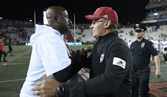 Indiana head coach Tom Allen, right, shakes hands with Maryland head coach Mike Locksley, left, after an NCAA college football game, Saturday, Oct. 19, 2019, in College Park, Md. (AP Photo/Nick Wass) **FILE**