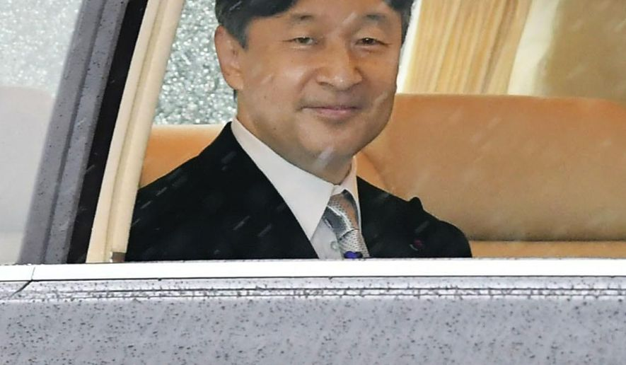 Japan's Emperor Naruhito depart for the Imperial Palace in Tokyo, Tuesday, Oct. 22, 2019.  Emperor Naruhito will declare Tuesday he had ascended to the Chrysanthemum Throne at the palace. (Kyodo News via AP)
