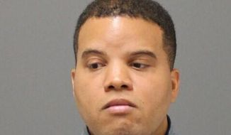 This mugshot provided by Connecticut State Police, shows Hamden police officer Devin Eaton, 29, who was arrested, Monday, Oct. 21, 2019, and charged with felony assault and reckless endangerment as a result of the use of force in an April, 2019 shooting in New Haven that left a woman wounded. (Connecticut State Police via AP)