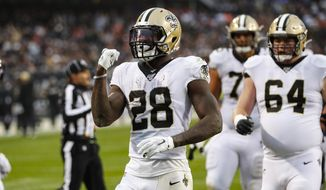 New Orleans Saints running back Latavius Murray (28) celebrates a touchdown during the second half of an NFL football game against the Chicago Bears in Chicago, Sunday, Oct. 20, 2019. (AP Photo/Charles Rex Arbogast)