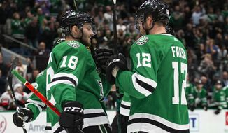 Dallas Stars center Radek Faksa (12) is congratulated by center Jason Dickinson (18) after scoring a goal during the first period of an NHL hockey game against the Ottawa Senators in Dallas, Monday, Oct. 21, 2019. (AP Photo/Sam Hodde)