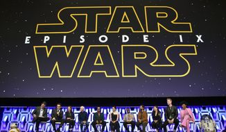 """FILE - In this April 12, 2019, file photo, Stephen Colbert, from left, J.J. Abrams, Kathleen Kennedy, Anthony Daniels, Billy Dee Williams, Daisy Ridley, John Boyega, Oscar Isaac, Kelly Marie Tran, Joonas Suotamo and Naomi Ackie participate in the """"Star Wars: The Rise of Skywalker"""" panel on day 1 of the Star Wars Celebration at Wintrust Arena in Chicago. Disney on Monday, Oct. 21, debuted the final trailer for """"Star Wars: The Rise of Skywalker,"""" the ninth installment in the """"Star Wars"""" film franchise that tells the story of the powerful Skywalker family. (Photo by Rob Grabowski/Invision/AP, File)"""
