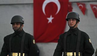 Turkish soldiers stand in attention during a ceremony for soldier Sefa Findik, killed in action with Kurdish fighters in Syria earlier Sunday, during a ceremony at the airport in Sanliurfa southeastern Turkey, Sunday, Oct. 20, 2019.It brings Turkey's military death toll up to seven soldiers in its wide-ranging offensive against Syrian Kurdish forces. (AP Photo/Lefteris Pitarakis)