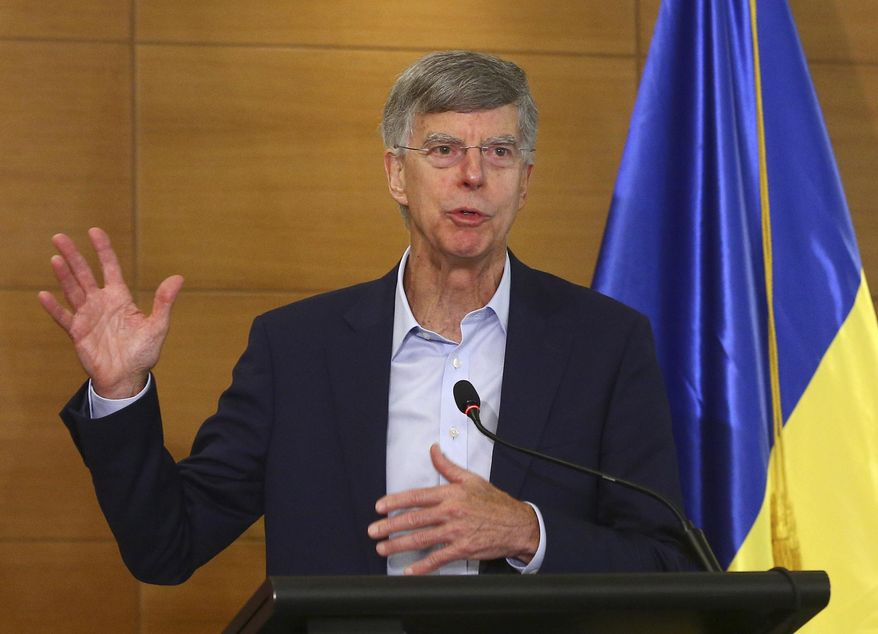 In this file photo taken on July 27, 2019, US Ambassador in Ukraine William Taylor speaks during a briefing in Kyiv, Ukraine. William Taylor, the top American diplomat in Ukraine, is set to appear Tuesday before impeachment investigators in U.S. Congress, joining a parade of current and former diplomats testifying about Trump's dealings with Ukraine.(AP Photo/Inna Sokolovska)