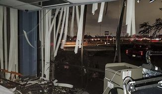 """In this Sunday, Oct. 20, 2019, photo offered by Lew Morris, damage to the KNON-FM radio station studio that hosts """"Reckless Rock Radio"""" is seen after a tornado touched down in Dallas, Texas. The National Weather Service confirmed a tornado touched down in Dallas on Sunday night, causing structural damage and knocking out electricity to thousands. (Lew Morris via AP)"""