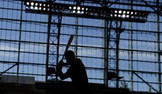 Houston Astros right fielder Kyle Tucker prepares to take batting practice for baseball's World Series Monday, Oct. 21, 2019, in Houston. The Houston Astros face the Washington Nationals in Game 1 on Tuesday. (AP Photo/Matt Slocum)