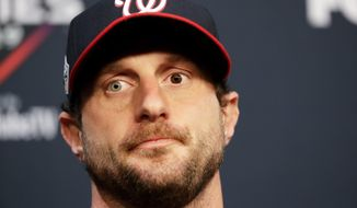 Washington Nationals starting pitcher Max Scherzer speaks during a news conference for baseball's World Series Monday, Oct. 21, 2019, in Houston. The Houston Astros face the Washington Nationals in Game 1 on Tuesday. (AP Photo/Eric Gay)