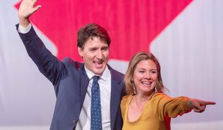 Canadian Prime Minister Justin Trudeau celebrates with his wife Sophie Gregoire Trudeau on Tuesday after winning a minority government. (ASSOCIATED PRESS)