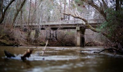 The 1946 lynching of two black couples at Moore's Ford Bridge above the Apalachee River in Monroe, Georgia, is prompting a U.S. court to consider whether federal judges can order grand jury records unsealed in old cases with historical significance. (ASSOCIATED PRESS)