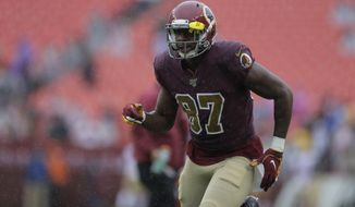 Washington Redskins tight end Jeremy Sprinkle works out before an NFL football game against the San Francisco 49ers, Sunday, Oct. 20, 2019, in Landover, Md. (AP Photo/Julio Cortez) ** FILE **