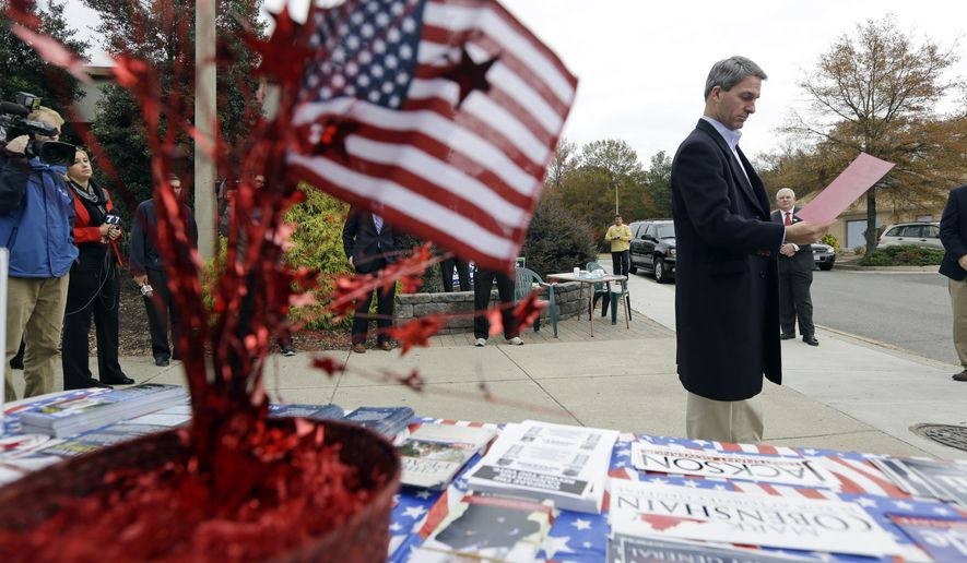 Republican gubernatorial candidate, Virginia Attorney General Ken Cuccinelli, looks over a sample ballot at the Atlee High School voting precinct in Hanover, Va., Tuesday, Nov. 5, 2013. Cuccinelli faces Democrat Terry McAuliffe in today's election. (AP Photo/Steve Helber) **FILE**