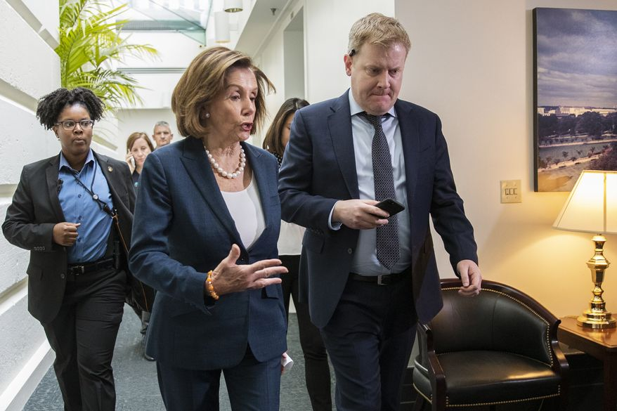 House Speaker Nancy Pelosi of Calif., walks with her staff at the conclusion of a House Democratic Caucus meeting on Capitol Hill in Washington, Tuesday, Oct. 22, 2019. (AP Photo/Manuel Balce Ceneta)