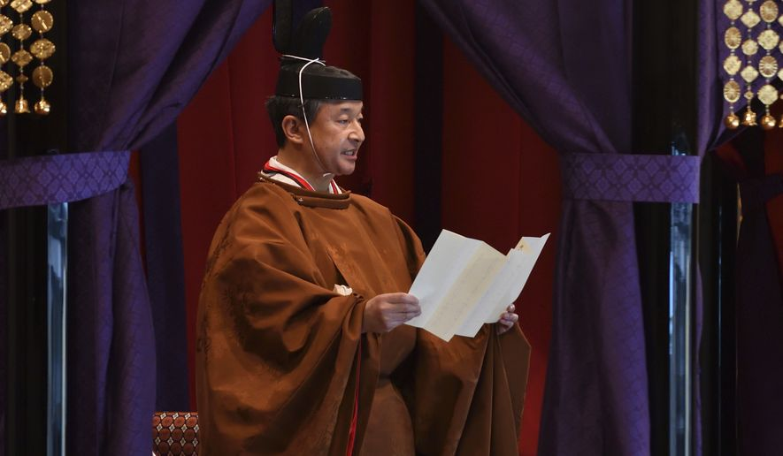 Emperor Naruhito delivers his speech during the enthronement ceremony where the emperor officially proclaims his ascension to the Chrysanthemum Throne at the Imperial Palace in Tokyo, Tuesday, Oct. 22, 2019. (Photo by Kazuhiro Nogi/Pool Photo via AP)
