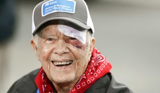 """In this Monday, Oct. 7, 2019 file photo, Former President Jimmy Carter answers questions during a news conference at a Habitat for Humanity project, in Nashville, Tenn. Carter has been hospitalized after an another fall at his home in Plains, Ga. A statement from The Carter Center says Carter suffered """"a minor pelvic fracture"""" on Monday, Oct. 21 but remains in good spirits and looks forward to recovering at home. (AP Photo/Mark Humphrey, File) **FILE**"""