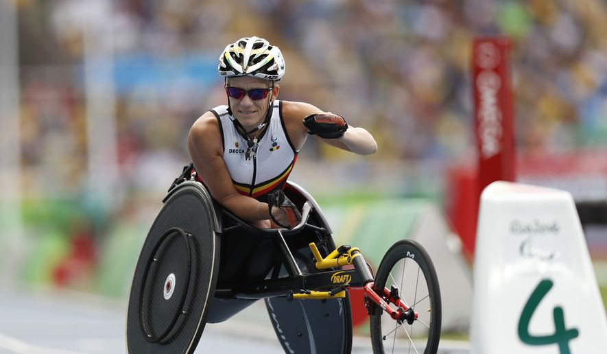 In this Sept. 10, 2016, file photo, Belgium's Marieke Vervoort warms up for the athletics women's 400-meter T52 final, during the Rio 2016 Paralympic Games, at the Olympic Stadium, in Rio de Janeiro, Brazil. Paralympian Vervoort said when the day arrived, she had signed the euthanasia papers and was prepared to end her life. The time came Tuesday, Oct. 22, 2019, in her native Belgium, her death confirmed in a statement from her home city of Diest. Vervoort, 40, won gold and silver medals in 2012 at the London Paralympics in wheelchair racing, and two more medals three years ago in Rio de Janeiro. (AP Photo/Mauro Pimentel, File)