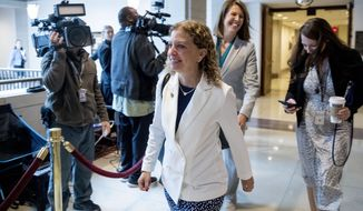 Rep. Debbie Wasserman Schultz, D-Fla., steps out of a closed door meeting where former U.S. Ambassador William Taylor testifies as part of the House impeachment inquiry into President Donald Trump, on Capitol Hill in Washington, Tuesday, Oct. 22, 2019. (AP Photo/Andrew Harnik)