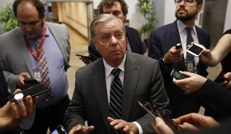 Sen. Lindsey Graham, R-S.C., speaks with members of the media, Tuesday, Oct. 22, 2019, on Capitol Hill in Washington. (AP Photo/Patrick Semansky)