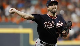 Washington Nationals starting pitcher Max Scherzer throws against the Houston Astros during the first inning of Game 1 of the baseball World Series Tuesday, Oct. 22, 2019, in Houston. (AP Photo/Matt Slocum) ** FILE **