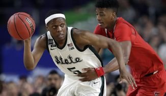 FILE - In this April 6, 2019, file photo, Michigan State's Cassius Winston (5) drives against Texas Tech's Jarrett Culver during the second half in the semifinals of the Final Four NCAA college basketball tournament in Minneapolis. Michigan State senior guard Cassius Winston, Marquette guard Markus Howard, Louisville junior forward Jordan Nwora, Seton Hall senior guard Myles Powell and Memphis freshman James Wiseman headline The (AP Photo/Jeff Roberson, File)