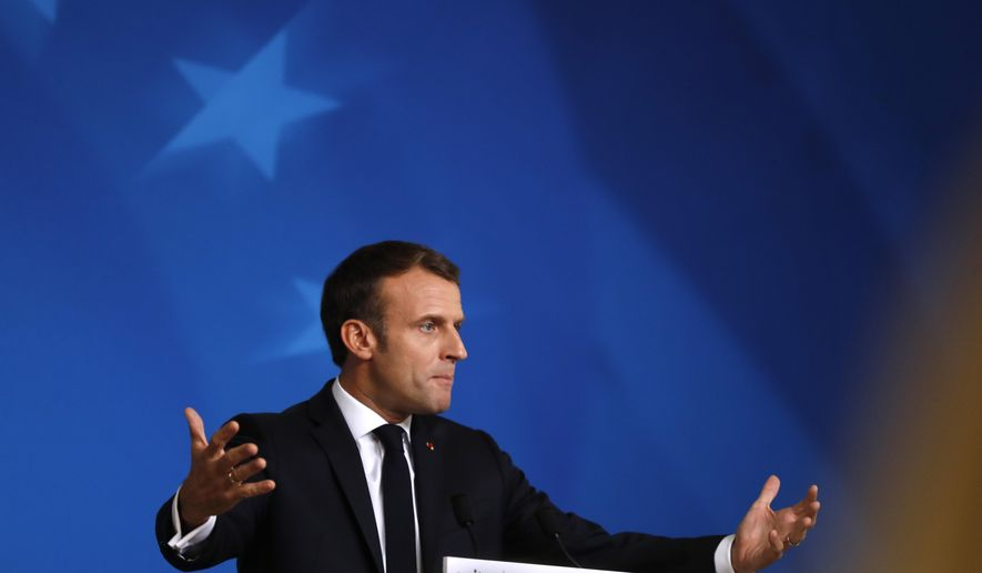 French President Emmanuel Macron speaks during a media conference at an EU summit in Brussels, Friday, Oct. 18, 2019. After agreeing on terms for a new Brexit deal, European Union leaders are meeting again to discuss other thorny issues including the bloc's budget and climate change. (AP Photo/Frank Augstein)