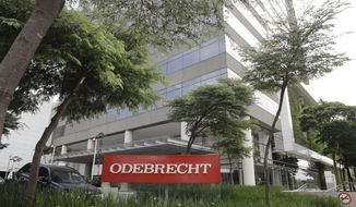 FILE - This April 12, 2018 file photo, shows the Odebrecht headquarters in Sao Paulo, Brazil. Swiss prosecutors filed on Tuesday, Oct. 22, 2019, their first indictment in investigations related to the Brazilian construction company and state-run oil giant Petrobras, charging a suspect with complicity in the bribery of foreign public officials and with money laundering. (AP Photo/Andre Penner, File)