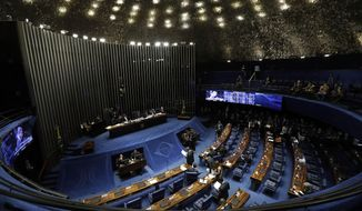 The Senate holds a final vote on pension reform in Brasilia, Brazil, Tuesday, Oct. 22, 2019. The most meaningful impact of the reform is the establishment of a minimum age for retirement at 65 for men and 62 for women. (AP Photo/Eraldo Peres)