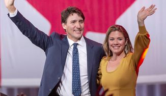 Liberal leader Justin Trudeau celebrates with his wife, Sophie Gregoire Trudeau, after winning a minority government at the election night headquarters Tuesday, Oct. 22, 2019 in Montreal. (Ryan Remiorz/The Canadian Press via AP)