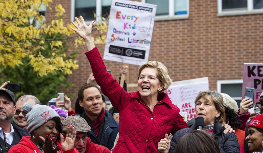 Presidential candidate U.S. Sen. Elizabeth Warren (D-MA) joins striking Chicago Teachers Union and SEIU Local 73 members for a speech on the picket line outside Oscar DePriest Elementary School on the West Side, Tuesday, Oct. 22, 2019. (Ashlee Rezin Garcia/Chicago Sun-Times via AP) **FILE**