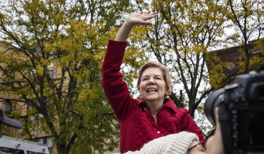 Presidential candidate Sen. Elizabeth Warren, D-Mass., waves goodbye to supporters after joining educators picketing outside Oscar DePriest Elementary School in Chicago, Tuesday, Oct. 22, 2019. Warren called for people across the country to support striking Chicago teachers. (Ashlee Rezin Garcia/Chicago Sun-Times via AP)