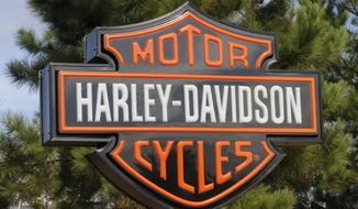 In this Oct. 17, 2019, photo Harley Davidson sign marks the entrance to a Harley Davidson dealership in Ashland, Va. Harley-Davidson, Inc. reports financial earns on Tuesday, Oct. 22, 2019. (AP Photo/Steve Helber)