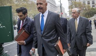 Ted Wells, Jr., center, the lead attorney for Exxon, leaves Manhattan Supreme court after opening arguments in a lawsuit against Exxon, Tuesday, Oct. 22, 2019, in New York.  The lawsuit brought on by New York's attorney general, claims the Texas energy giant kept two sets of books — one accounting for climate change regulations and the other underestimating the costs — to make the company appear more valuable to investors. (AP Photo/Mary Altaffer)