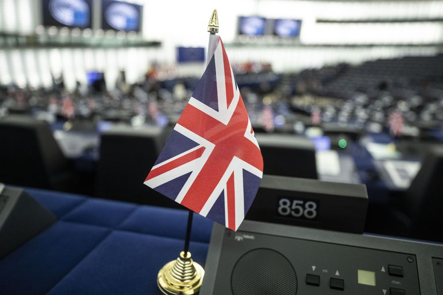 The Union Jack is seen Tuesday, Oct. 22, 2019 at the European Parliament in Strasbourg. Britain faces another week of political gridlock after British lawmakers on Monday denied Prime Minister Boris Johnson a chance to hold a vote on the Brexit divorce bill agreed in Brussels last Thursday. (AP Photo/Jean-Francois Badias)