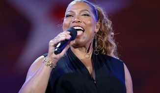FILE - In this Wednesday, July 3, 2019, file photo, Queen Latifah performs during the dress rehearsal for the Boston Pops Fireworks Spectacular in Boston. Harvard is set to award the W.E.B. Du Bois Medal to Queen Latifah and six other recipients on Tuesday, Oct. 22, 2019, according to the Cambridge, Massachusetts, school's Hutchins Center for African and African American Research. (AP Photo/Michael Dwyer, File)