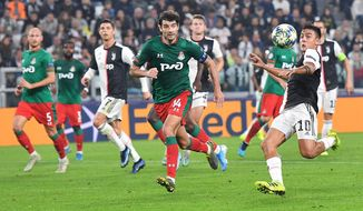 Juventus' Paulo Dybala, right, and Lokomotiv Moscow's Vedran Corluka in action during the UEFA Champions League group D soccer match at the Allianz Stadium in Turin, Italy, Tuesday, Oct. 22, 2019. (Alessandro Di Marco/ANSA via AP)