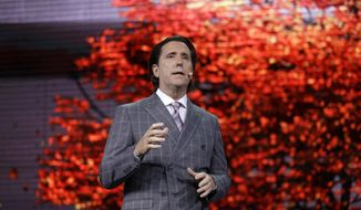 Alfonso Albaisa, senior vice president for Global Design for Nissan Motor Corp., speaks during Nissan's presentation of the media preview of the Tokyo Motor Show Wednesday, Oct. 23, 2019, in Tokyo. (AP Photo/Kiichiro Sato)