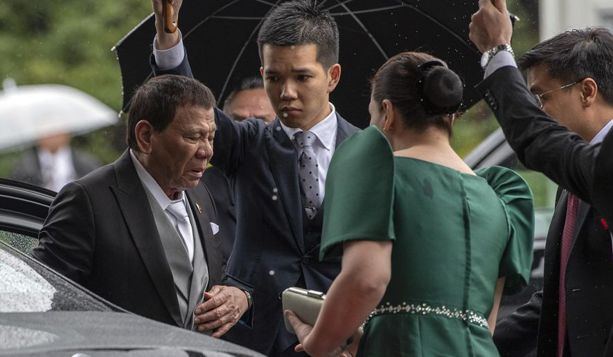Philippines President, Rodrigo Duterte arrives to attend the enthronement ceremony of Emperor Naruhito of Japan at the Imperial Palace on Tuesday, Oct. 22, 2019 in Tokyo. (Carl Court/Pool Photo via AP)