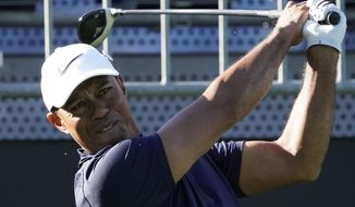 Tiger Woods of the United States watches his tee shot on the 10th hole during the pro-am event of he Zozo Championship PGA Tour at Accordia Golf Narashino C.C. in Inzai, east of Tokyo, Japan, Wednesday, Oct. 23, 2019. (AP Photo/Lee Jin-man)