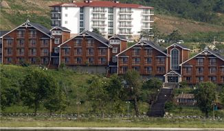 FILE - In this Sept. 1, 2011, file photo, South Korean invested villas line the coastline of the Mount Kumgang resort, also known as Diamond Mountain, in North Korea. North Korean leader Kim Jong Un has ordered the destruction of South Korean-made hotels and other tourist facilities at the North's Diamond Mountain resort, apparently because Seoul won't defy international sanctions and resume South Korean tours at the site, Pyongyang's official Korean Central News Agency said Wednesday, Oct. 23, 2019. (AP Photo/Ng Han Guan, File)